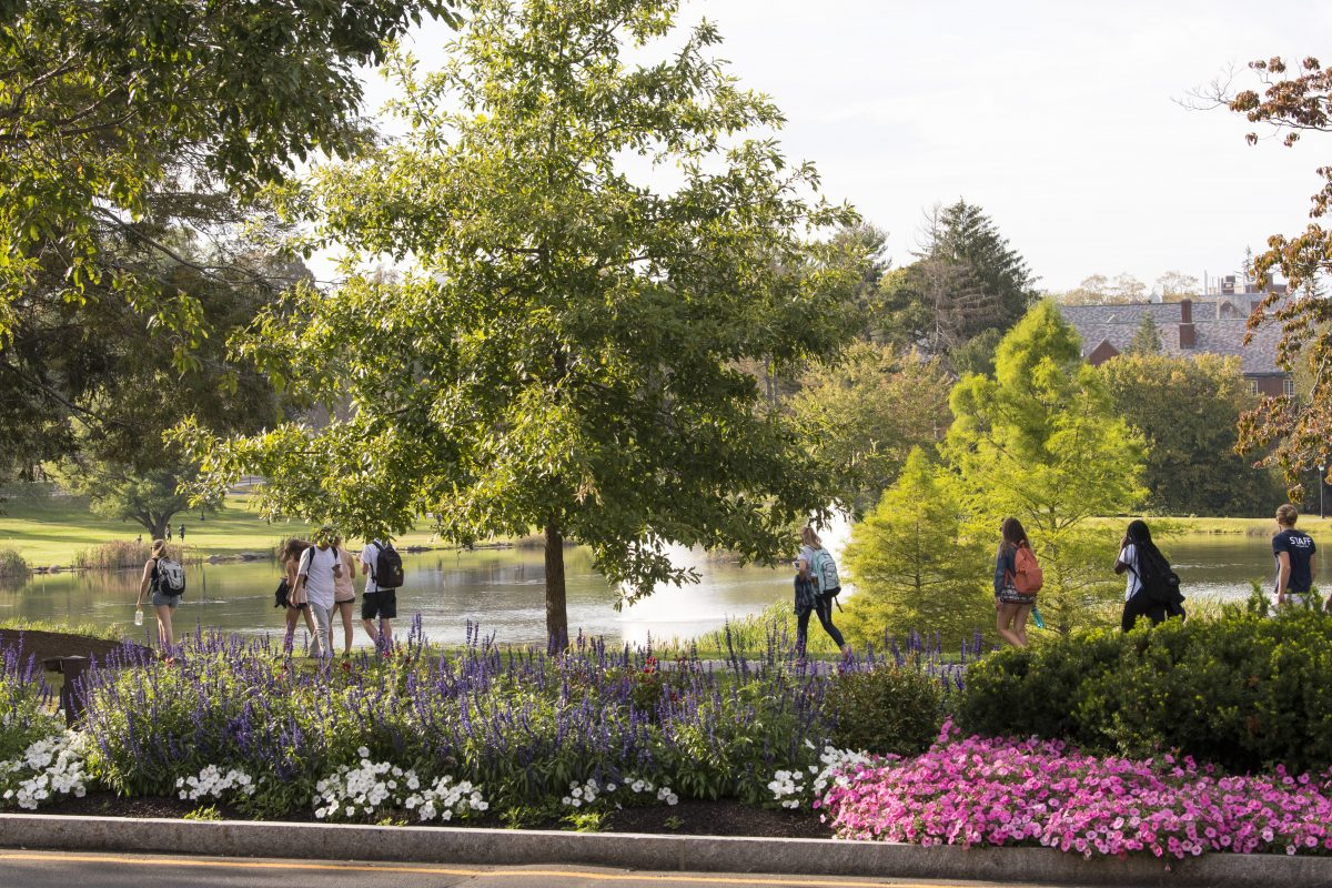 Students walk near Mirror Lake on the Storrs Campus